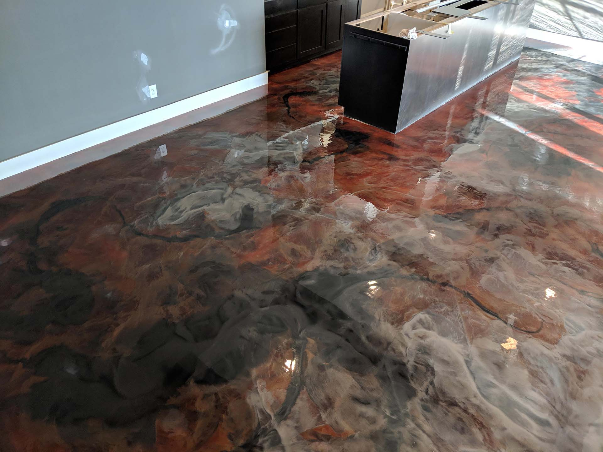 completed metallic epoxy flooring with red marbled finish